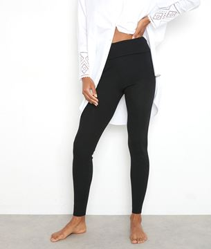 Picture of THEO LEGGING-STYLE TROUSERS IN BLACK RIBBED WOOL